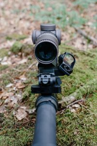 A red dot sight mounted on tactical rifle