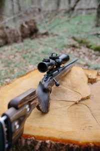A red dot sight mounted on a hunting rifle