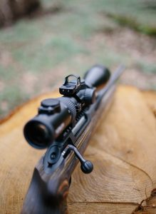 A red dot sight mounted on top