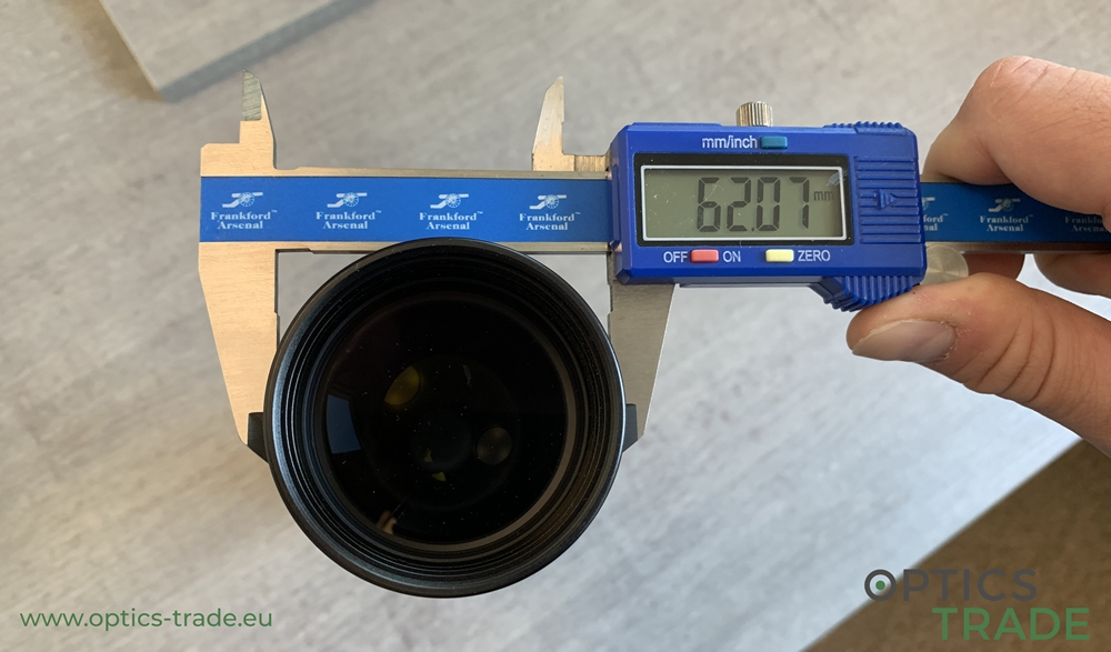 The outer objective diameter of a riflescope measured with a measuring tool
