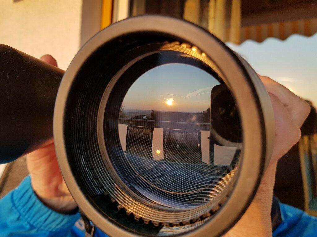 Binoculars and Sun